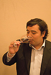 Chile Wine Country: Hector Riquelme of World of Wine in Santiago, tasting wine..Photo #: ch401-32800..Photo copyright Lee Foster, 510-549-2202, www.fostertravel.com, lee@fostertravel.com.