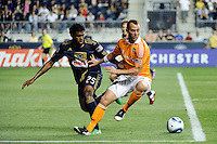 Brad Davis (11) of the Houston Dynamo and Sheanon Williams (25) of the Philadelphia Union. The Philadelphia Union and the Houston Dynamo played to a 1-1 tie during a Major League Soccer (MLS) match at PPL Park in Chester, PA, on August 6, 2011.