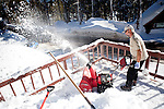 Cort Meredith clears snow from his deck in Soda Springs, Calif., January 6, 2011. California has already received 80% of its normal annual precipitation in the first two months of a rainy season that lasts another four months..CREDIT: Max Whittaker for The Wall Street Journal.CALWATER
