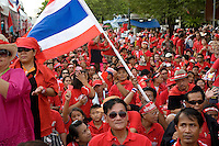 Thailand. Bangkok. Red-shirted supporters of ousted premier Thaksin Shinawatra gather outside Government House to demand the dissolution of the House of Representatives and the resignation of the Democrat led coalition. Thousand of anti-government Democratic Alliance against Dictatoship (DAAD) protesters shout slogans while demonstrating. Each day by late afternoon, the red-shirt uprising swells with thousand supporters to hear verbal attacks against the government. A new political crisis with the red power political movement.  29.03.09 © 2009 Didier Ruef