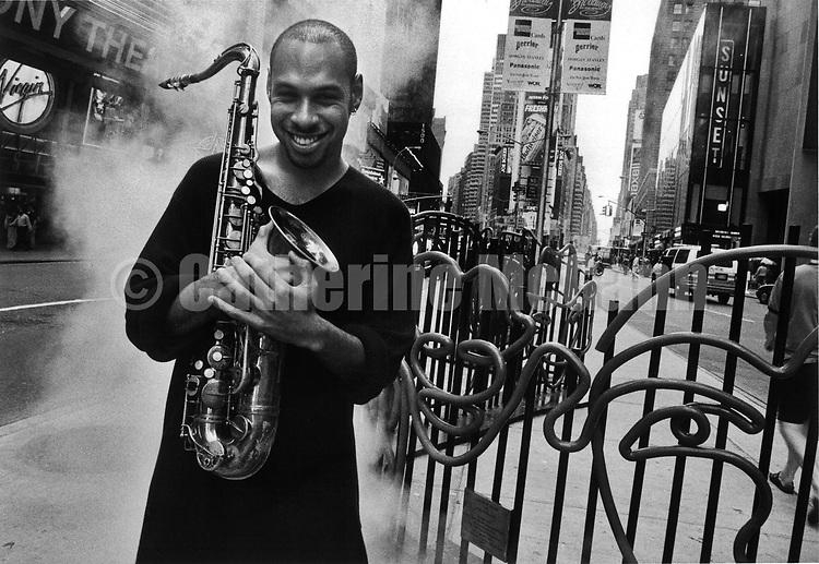 NEW YORK - MID 1990's:  American jazz musician Joshua Redman poses for a portrait holding his saxophone in the mid 1990's in New York City,  New York. (Photo by Catherine McGann).Copyright 2010 Catherine McGann