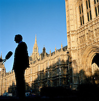UK. London. Abingdon Street Gardens in front of The Houses of parliament in Westminster. This small patch of land, often referred to as College Green, is the place where the media and the politicians come face to face. Interviews are held, photo shoots are set up as bewildered tourists stroll past..Photo©Steve Forrest/Workers Photos