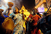 INDIA (West Bengal - Calcutta)  2008, Durgapuja is the time for merry making. Elderly ladies dancing on the rythm of drums.  Durga Puja Festival is the biggest festival among bengalies.  As Calcutta is the capital of West Bengal and cultural hub of  the bengali community Durga puja is held with the maximum pomp and vigour. Ritualistic worship, food, drink, new clothes, visiting friends and relatives places and merryment is a part of it. In this festival the hindus worship a ten handed godess riding on a lion armed wth all possible deadly ancient weapons along with her 4 children (Ganesha - God for sucess, Saraswati - Goddess for arts and education, Laxmi - Goddess of wealth and prosperity, Kartikeya - The god of manly hood and beauty). Durga is symbolised as the women power in Indian Mythology.  In Calcutta people from all the religions enjoy these four days of festival in the moth of October. Now the religious festival has become the biggest cultural extravagenza of Calcutta the cultural capital of India. Artistry and craftsmanship can be seen in different sizes and shapes in form of the idol, the interior decor and as well as the pandals erected on the streets, roads and  parks.- Arindam Mukherjee