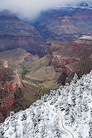 Hikers on upper section of Bright Angel trail covered in snow, Grand Canyon national park, Arizona, USA