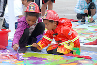 Zoe, 7, and her brother Zane, 3, paint on Santa Monica Malibu Education Foundation and PTA's 'Painting Circle' during the 5th Annual Unity Resource Festival at Virginia Avenue Park on Sunday, March 6, 2011.