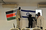 Sudanese in southern Tel Aviv hang Israeli flag next to theirs, as they celebrate the independence of South Sudan, which was declared a day earlier.