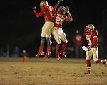 Lafayette High's Brandon Mack (4) and Lafayette High's Jeremiah Jones (26) celebrate an interception vs. Louisville in MHSAA 4A playoff action at William L. Buford Field in Oxford, Miss. on Friday, November 18, 2011. Lafayette won 28-6 and will advance to play Amory.