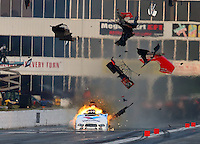 May 17, 2014; Commerce, GA, USA; NHRA funny car driver Jack Beckman explodes an engine sending pieces of the carbon fiber body into the air during qualifying for the Southern Nationals at Atlanta Dragway. Beckman was unhurt in the explosion. Mandatory Credit: Mark J. Rebilas-USA TODAY Sports