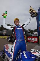 Mar. 17, 2013; Gainesville, FL, USA; NHRA pro stock motorcycle rider Hector Arana Jr celebrates after winning the Gatornationals at Auto-Plus Raceway at Gainesville. Mandatory Credit: Mark J. Rebilas-