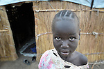 A displaced girl in Agok, a town in the contested Abyei region where tens of thousands of people fled in 2011 after an attack by soldiers and militias from the northern Republic of Sudan on most parts of Abyei. Although the 2005 Comprehensive Peace Agreement called for residents of Abyei--which sits on the border between Sudan and South Sudan--to hold a referendum on whether they wanted to align with the north or the newly independent South Sudan, the government in Khartoum and northern-backed Misseriya nomads, excluded from voting as they only live part of the year in Abyei, blocked the vote and attacked the majority Dinka Ngok population. The African Union has proposed a new peace plan, including a referendum to be held in October 2013, but it has been rejected by the Misseriya and Khartoum.