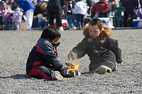 Children play at the Nalukataq festival, celebrating the successful subsistence spring Bowhead whale hunt, Utqiagvik (Barrow), Alaska.