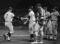 New York Yankee Mickey Mantle greeted at home by teammates after home run against the Oakland Athletics (1968 photo by Ron Riesterer)
