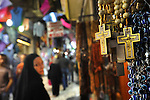 Christian souvenirs for sale along Via Dolorosa, a street within Jerusalem's old city, Israel, which is believed to be the path that Jesus Christ walked carrying his cross, on his way to crucifixion.