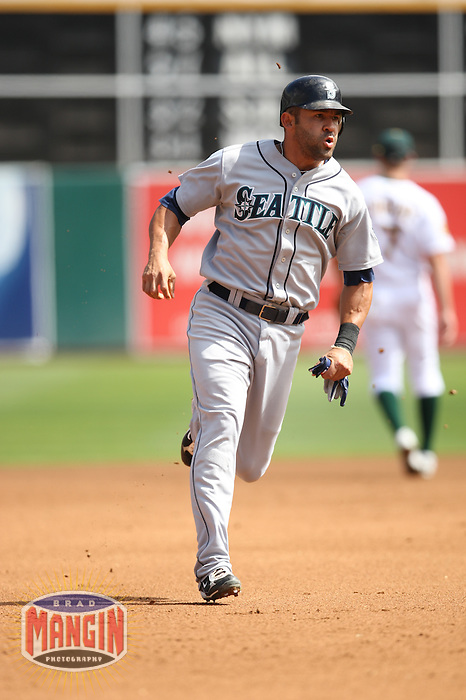 OAKLAND, CA - SEPTEMBER 20:  Miguel Cairo of the Seattle Mariners runs the bases during the game against the Oakland Athletics at the McAfee Coliseum in Oakland, California on September 20, 2008.  The Athletics defeated the Mariners 8-7.  Photo by Brad Mangin