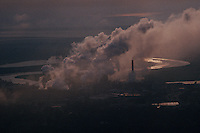 Smoke spews from the Gilman Paper Company mill on the North River. Although regulations control the amount of pollution emitted into the atmosphere, foul fumes permeate the <br /> region. The company produced 2.6 million pounds of paper per day. Gilman Paper Company employed 1,100 workers and 1,500 independent woodcutters.