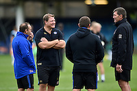 Bath Rugby coaches have a chat with Exeter Chiefs head coach Rob Baxter during the pre-match warm-up. West Country Challenge Cup match, between Bath Rugby and Exeter Chiefs on October 10, 2015 at the Recreation Ground in Bath, England. Photo by: Patrick Khachfe / Onside Images