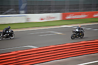 Motorcyclists race at the Silverstone Grand Prix circuit, Northamptonshire