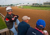 Jockey Joe Johnson watches morning workouts for the Kentucky Derby and Kentucky Oaks at Churchill Downs in Louisville, Kentucky on April 30, 2012.