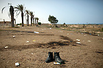 The earth is burned where 53 bodies were found behind the Mahari Hotel in Sirte, Libya, Oct. 25, 2011. The dead appeared to be pro-Gaddafi detainees who were executed by revolutionary forces.