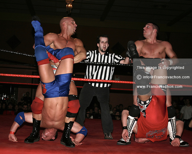 Pro Wrestler Christopher Daniels (left) applies a hold on AJ Style while as Excess  does the same on Kevin Steen during a professional wrestling match of the Elite Wrestling Revolution federation event held at Le Centre Horizon in Quebec City January 8, 2005<br />