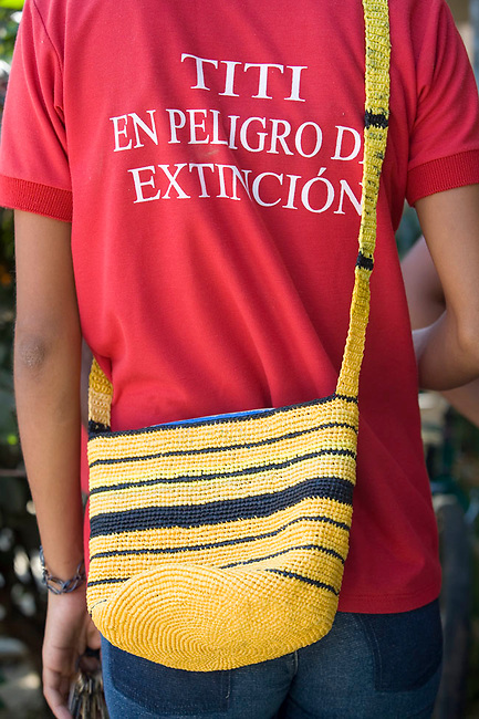 "Colombian woman wears a ""tamarins in danger of extinction"" t-shirt and an eco-mochila.  Los Limites, Colombia."