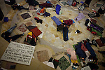 Protestors sleep in the rotunda of the Wisconsin State Capitol over a bill that threatens to strip collective bargaining rights in Madison, Wisconsin, February 25, 2011.