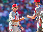 7 September 2014: Philadelphia Phillies Manager Ryne Sandberg relieves starting pitcher Cole Hamels of the ball during a game against the Washington Nationals at Nationals Park in Washington, DC. The Phillies fell to the Nationals 3-2 in their final meeting of the season. Mandatory Credit: Ed Wolfstein Photo *** RAW (NEF) Image File Available ***