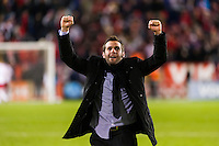 D. C. United head coach Ben Olsen celebrates after the match. D. C. United defeated the New York Red Bulls 1-0 (2-1 in aggregate) during the second leg of the MLS Eastern Conference Semifinals at Red Bull Arena in Harrison, NJ, on November 8, 2012.