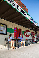 Austinites enjoy a cold beer while hanging out at a favorite Eastside eatery in East Austin's East 6th Street.