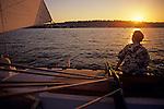 Woman enjoying sailing on a sunny day at sunset on Lake Washington Seattle Washington State USA