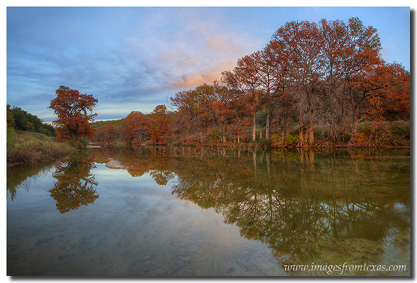 The cypress were changing color - from green to red and orange - on this cool November day in the Texas Hill Country. I had gone to Pedernales Falls to take some photos of the changing colors, and for a brief moment, the clouds offered some pastel pinks and blues as the sun began to fade in the west.