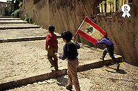 Lebanon, Beirut, Three boys carrying Lebanese flag on steps, rear view (Licence this image exclusively with Getty: http://www.gettyimages.com/detail/sb10068808f-001 )