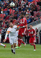 20 April 2013: Houston Dynamo forward Will Bruin #12 and Toronto FC defender Gale Agbossoumonde #6 in action during the second half in an MLS game between the Houston Dynamo and Toronto FC at BMO Field in Toronto, Ontario Canada..The game ended in a 1-1 draw...
