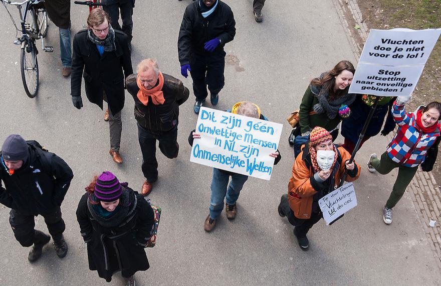 Nederland, Amsterdam, 23 maart 2013<br /> Demonstratie tegen het beleid om vluchtelingen en uitgeproduceerde asielzoekers in de gevangenis te stoppen. <br /> <br /> Foto(c): Michiel Wijnbergh