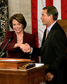 Washington, D.C. - January 4, 2007 --  United States Representative Nancy Pelosi (Democrat of the 8th District of California) shakes hands with U.S. Representative John Boehner (Republican of the 8th District of Ohio), the Minority Leader, after she was sworn-in as the Speaker of the United States House of Representatives in the Capitol in Washington, D.C. on Thursday, January 4, 2007.  Speaker Pelosi is the first woman in U.S. history to serve in that position..Credit: Ron Sachs / CNP