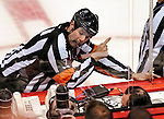 17 October 2009: NHL Referee Bill McCreary discusses a call with NHL officials during a game between the Ottawa Senators and the Montreal Canadiens at the Bell Centre in Montreal, Quebec, Canada. The Senators defeated the Canadiens 3-1. Mandatory Credit: Ed Wolfstein Photo