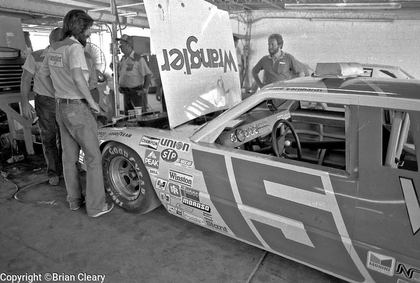 Crewmen work on the #15 Ford Thunderbird of Dale Earnhardt before the Firecracker 400 Daytona International Speedway Daytona Beach FL July 1982.(Photo by Brian Cleary/www.bcpix.com)(Photo by Brian Cleary/www.bcpix.com)