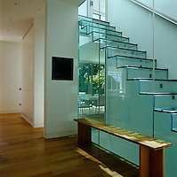This glass staircase is part of the 'band of glass' that separates the old and new parts of the house