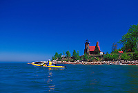 A sea kayaker paddles near Sand Island Lighthouse in Apostle Islands National Lakeshore near Bayfield, Wis.