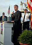 Freeport, New York, USA. 10th Sept. 2014. A pastor gives a blessing at a dockside remembrance ceremony in honor of victims of the terrorist attacks of September 11 2001, at the boat Miss Freeport V, on Freeport's Nautical Mile. Further ceremonies were held on board the vessel, which sailed from the Woodcleft Canal on the South Shore of Long Island, on the eve of the 13th Anniversary of the 9/11 attacks.