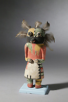Wupamo katsina doll, made c. 1910 by a Hopi artist from wood, paint, feathers and string, anonymous gift in the name of Julia Johnson, in the collection of Denver Art Museum, Denver, Colorado, USA. Hopi katsina figures or kachina dolls are figures carved, typically from cottonwood root, by Hopi people to teach girls about katsinas or katsinam, the immortal beings that bring rain and act as messengers between humans and the spirits. Wupamo katsina are guards, one of the Mongwi or Chief Katsinam. The Hopi tribe live in North East Arizona and have been making these katsina figures since the 19th century. Picture by Manuel Cohen