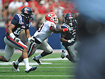 Ole Miss' Jeff Scott (3) runs against Georgia cornerback Sanders Commings (19) as Ole Miss' Donte Moncrief (12) blocks at Vaught-Hemingway Stadium in Oxford, Miss. on Saturday, September 24, 2011. Georgia won 27-13.
