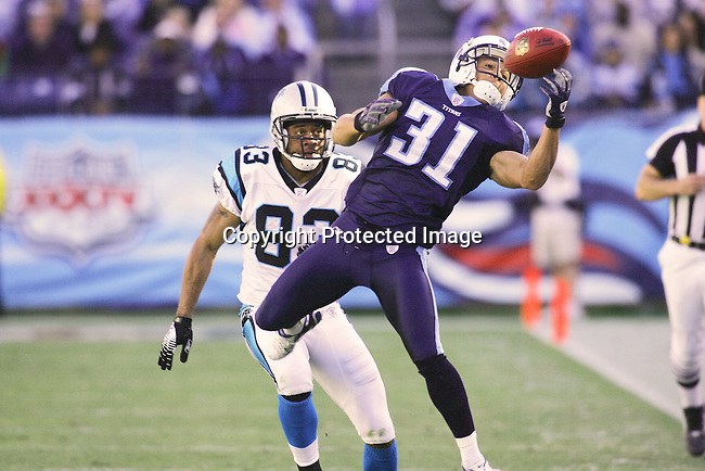 Tennessee Titan cornerback, Cortland Finnegan, intercepts a ball intended for Carolina Panther wide receiver Keary Colbert.  Tennessee defeated Carolina 20-7 November 4, 2007 in Nashville, Tennessee.