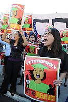 Mesa, Arizona. February 23, 2012 - As Republican candidates debated in the Mesa Arts Center, protesters including undocumented students, tea partiers, occupy movement members and Syrian president opponents, shouted slogans and held up signs and placards outside. In this photograph, a group of undocumented students who live in the United States without legal status and who advocate for the DREAM Act, protest against Mitt Romney, the Republican candidate who said he would veto the proposed legislation if he becomes president. Photo by Eduardo Barraza © 2012