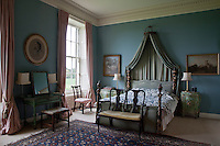 One of a number of ornately carved beds at Clandeboye is adorned with a rich variety of textiles and furnishings