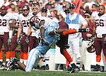 09 September 2006: Virginia Tech's David Clowney (87) is tackled by North Carolina's Jacoby Watkins (16). The University of North Carolina Tarheels lost 35-10 to the Virginia Tech Hokies at Kenan Stadium in Chapel Hill, North Carolina in an Atlantic Coast Conference NCAA Division I College Football game.
