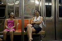 Sisters; Subway riders. Street photography in NY August 5, 2007