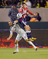 Chivas USA midfielder Sacha Kljestan battles LA Galaxy forward Landon Donovan. The LA Galaxy defeated Chivas USA 2-0 during the Super Clasico at Home Depot Center stadium in Carson, California Thursday evening April 1, 2010.  .