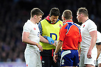 Owen Farrell of England has his wrist treated during a break in play. RBS Six Nations match between England and France on February 4, 2017 at Twickenham Stadium in London, England. Photo by: Patrick Khachfe / Onside Images