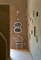 As in a traditional Moroccan house one wall of the entrance hall is punctuated with niches of different shapes and sizes
